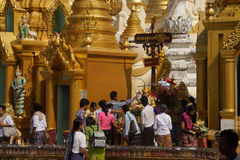 Offering of holy water at planetary post. YANGON, BURMA - FEB 18, 2015 - Offering of holy water at planetary post, name day, shrine, Shwedagon Pagoda Yangon ( Stock Photography