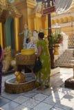 Offering of holy water at planetary post. YANGON, BURMA - FEB 18, 2015 - Offering of holy water at planetary post, name day, shrine, Shwedagon Pagoda Yangon ( Royalty Free Stock Photos