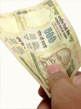 Offering Indian currency Stock Image