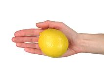 Offering a lemon (+ clipping). Woman?s hand offering a ripe lemon. Isolated on white, with clipping path stock images