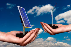 Offering new energy. Hand offering renewable energy systems royalty free stock photography