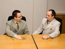 Offering performance bonus. Business people distributing performance bonuses - business concept royalty free stock image