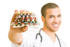 Offering pills Royalty Free Stock Image
