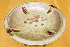 Offering plate religious church coins donation Royalty Free Stock Image