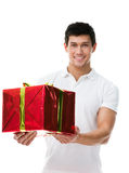 Offering a present sporty man Stock Photo