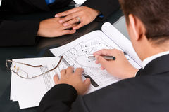 Offering property site. A broker is offering the property site by showing it on a map Stock Photo