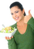 Offering Salad. Happy young woman showing healthy delicious salad. healthy lifestyle stock photography