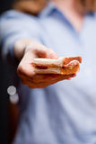 Offering a sandwich Stock Photo