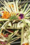 Offering to Hindu Gods in Bali island which called Canang and made from leaves and flowers.  royalty free stock image
