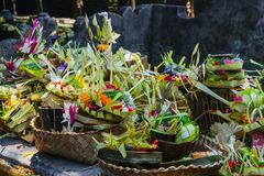 Offering to Hindu Gods in Bali island which called Canang and made from leaves and flowers.  royalty free stock photography