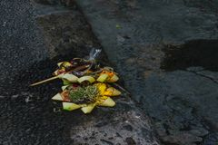 Offering to Hindu Gods in Bali island which called Canang and made from leaves and flowers.  royalty free stock photos