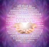 Offering you the Humble Words of a Healer. Female cupped hands surrounded by a HEAL word tag cloud on a pink purple flowing energy background Stock Photography