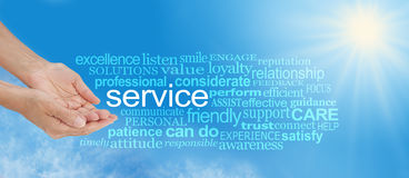 Offering You Service Word Cloud. Female hands in cupped offering gesture with the word SERVICE surrounded by a relevant gold colored word cloud on blue sky and royalty free stock images