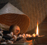 Offerings crops placed on bamboo container. And lit the traditional lamp Indonesia like candle Stock Photos
