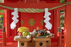Offerings of food left at a Japanese shinto shrine Stock Images