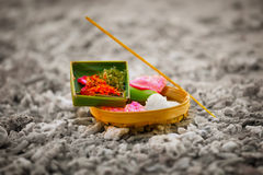 Offerings to gods in Bali with flowers, rice and aroma stick Stock Images