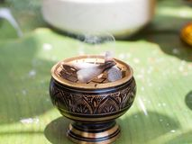 Offerings to gods with burning incense aroma sticks. Stock Photos