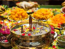 Offerings to gods with burning incense aroma sticks , flowers an Royalty Free Stock Images