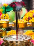 Offerings to gods with burning incense aroma sticks , flowers an Stock Image