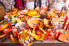 Offerings to gods in  temple with flowers, food and aroma sticks Stock Image