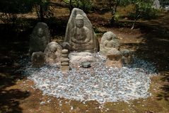 Offerings to Stone Idols, Kyoto, Japan Royalty Free Stock Photo
