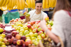 Offers customer at street market Royalty Free Stock Image