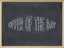 Offers of the Day meat written on a blackboard Royalty Free Stock Photos