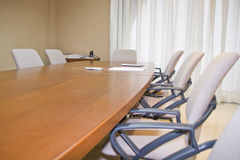 Office. Modern conference office with long formal table and chairs Stock Photo