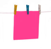 Office. Paper leaf attached by writing clothespins Royalty Free Stock Photo