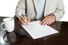 Office. Businessman writes a pen on an empty paper royalty free stock photo