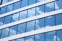 Office. Building windows with Clouds reflection royalty free stock photos
