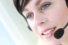 Office. Image of a receptionist with headphones Stock Photo