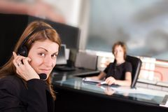 At the office. Operater answering the calls in the office royalty free stock image