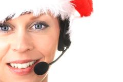 Office. Image of a receptionist with headphones at Christmas Stock Photography