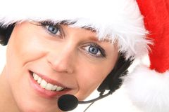 Office. Image of a receptionist with headphones at Christmas Stock Photo