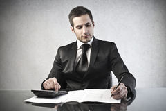Office. Young businessman working at his desk Stock Image