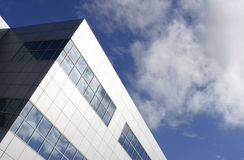 The Office. Sleek modern office block with aluminum facade __ with room for text Royalty Free Stock Images