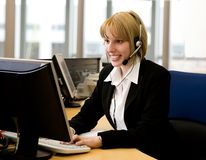 At the office. Young businesswoman working at the office royalty free stock photography