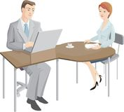 The office. The man of middle age and the woman sit at a table in working conditions Royalty Free Stock Photography