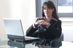 Office 820. A pretty woman in office with portable Stock Photo