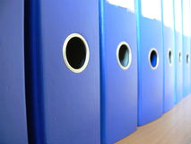 Office. Row of blue ring binders Royalty Free Stock Photography
