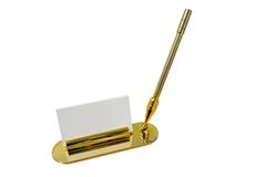 Office accessories. Pen and card holder in gold Stock Photography