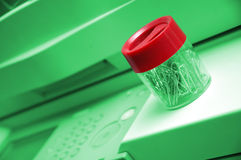 Office accessories. Red and green office accessories on copier machine stock photos