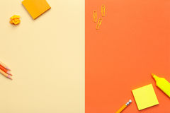 Office Accessories on Yellow and Orange Background Royalty Free Stock Image