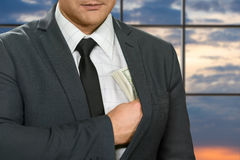 Office administrator hides dollars. Royalty Free Stock Photo