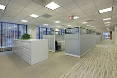 Office area with cubicles. In high rise building Stock Images