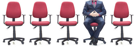 Office armchairs. Empty office armchairs and one with person Royalty Free Stock Image