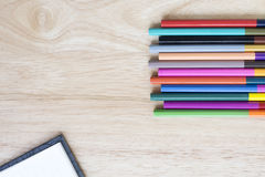 Office and arte stationery objects on wood table with a notebook Stock Photo