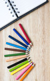 Office and arte stationery objects on wood table with a notebook Stock Image