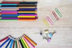 Office and arte stationery objects on wood table with a notebook Stock Photos